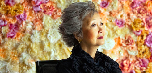 drienne Clarkson portrait in front of flowery backdrop