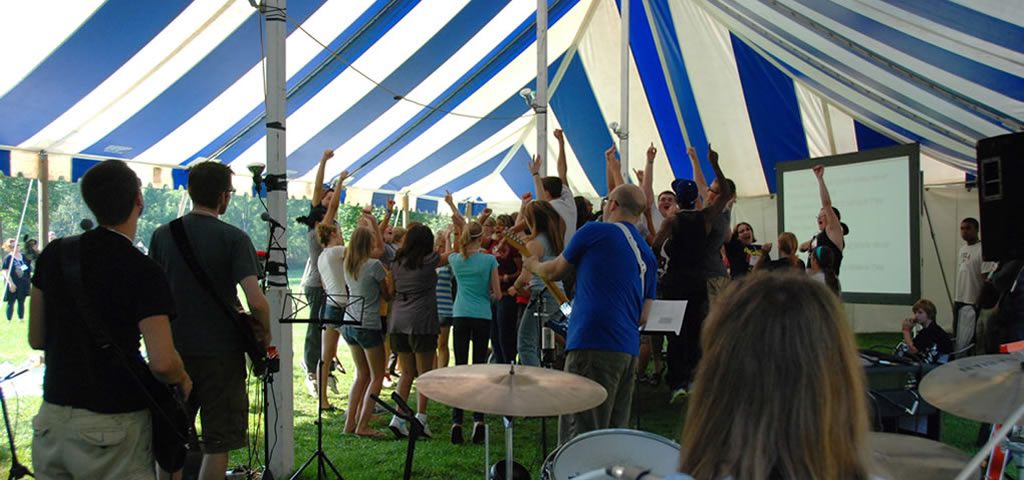 Band performing under tent