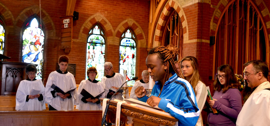 Girl speaking at pulpit during Mass